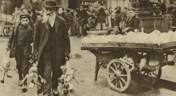 Jewish elder and his grandson buying food from a market in Wentworth Street, Stepney (b/w photo)