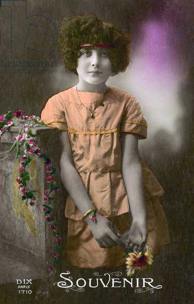 Little girl in orange (colour photo)