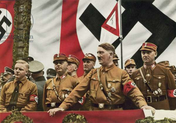 Nazi leader Adolf Hitler with Josef Wagner, Gauleiter of South Westphaliam and senior members of the SA Wilhelm Schepmann and Victor Lutze at a rally in Dortmund, Germany, 1933 (colour photo)