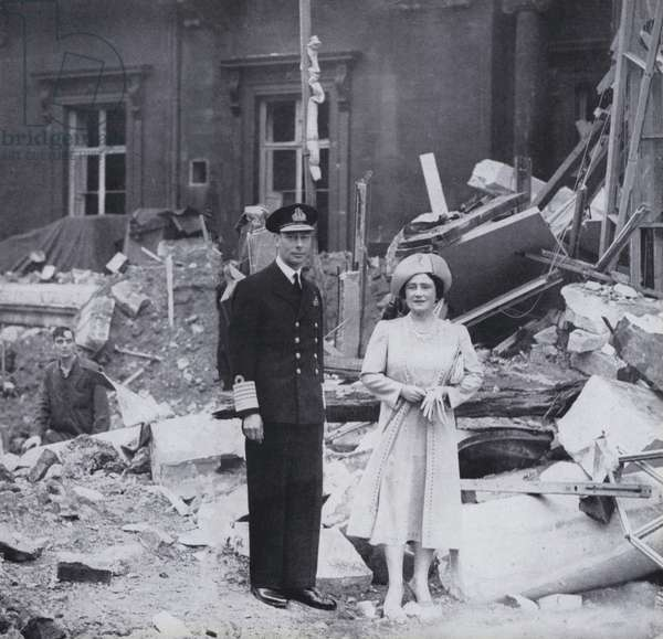 King George VI and Queen Elizabeth standing in the rubble of Buckingham Palace, London, after the bombing in 1940 (b/w photo)