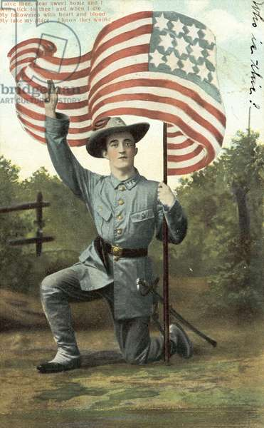 American soldier holding the Stars and Stripes (colour photo)