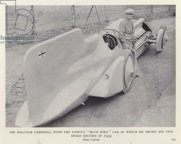 "Sir Malcolm Campbell with the famous ""Blue Bird"" car in which he broke his own speed record in 1933 (b/w photo)"