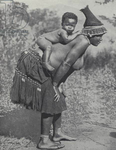 Woman carrying her baby on her back, South Africa (b/w photo)