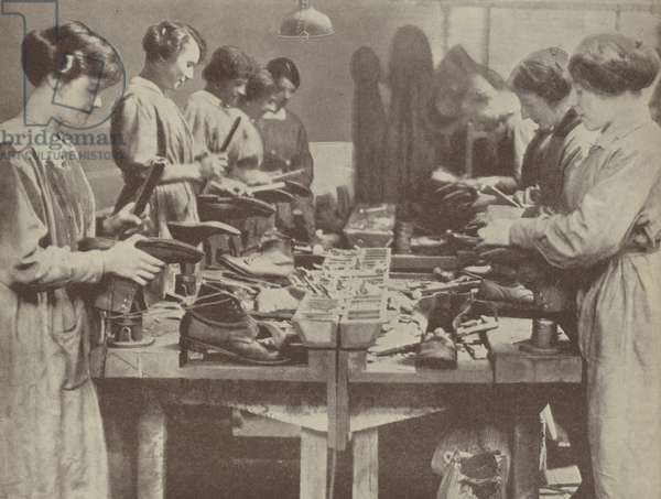British women cobblers repairing footwear for those serving in the forces during the First World War (b/w photo)