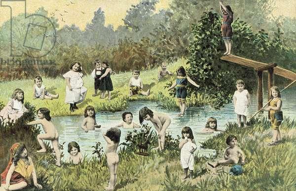 Children swimming in a river (colour photo)