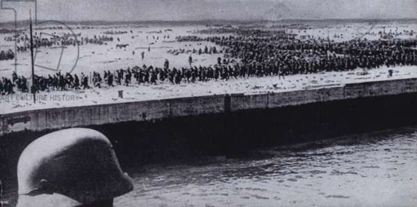 German soldier surveying Allied prisoners on the beach at Dunkirk, France, World War II, June 1940 (b/w photo)