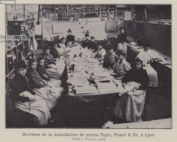 Women working at the corset making factory of Papin, Picard & Cie, Lyon, France (b/w photo)