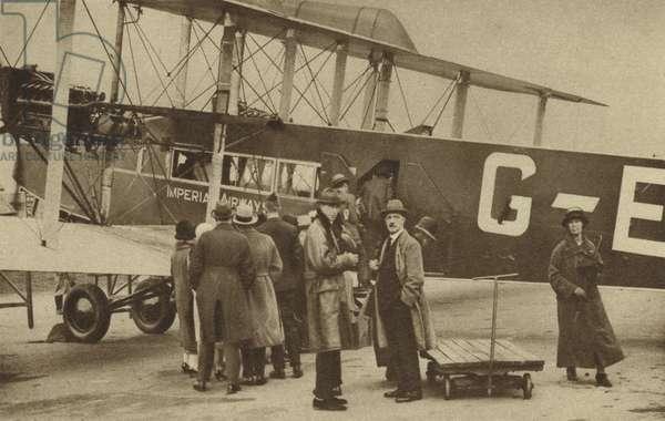 Passengers boarding an Imperial Airways flight to Paris at Croydon Aerodrome (b/w photo)