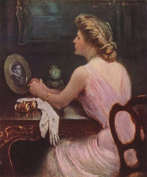Woman sitting at her dressing table looking at a photograph of a man, possibly her husband or lover (colour litho)