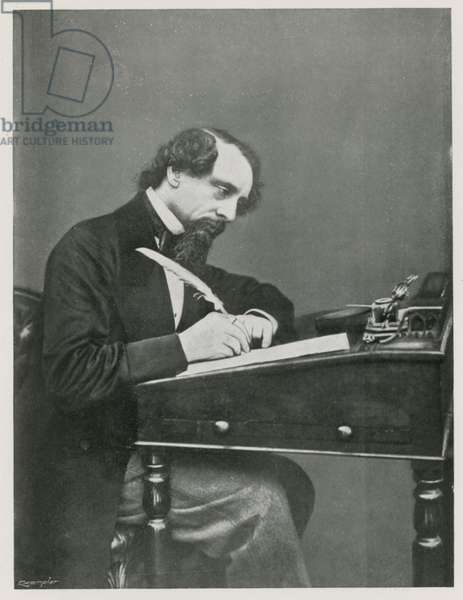 Charles Dickens at his desk (b/w photo)