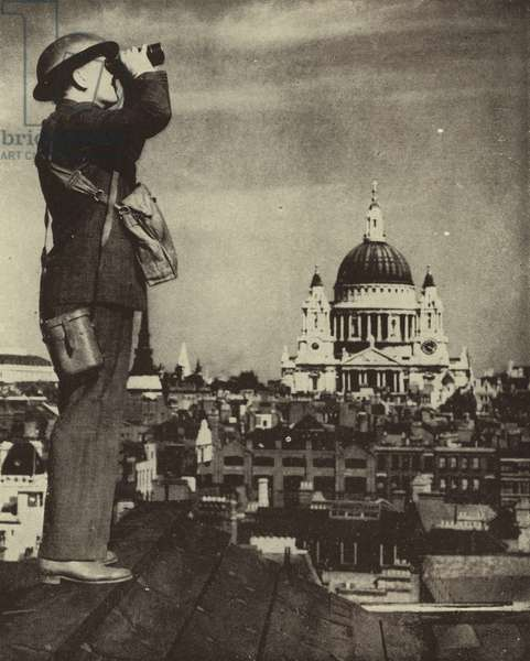 Aircraft spotter looking out for German bombers from a London rooftop during the Blitz, World War II, 5 September 1940 (b/w photo)