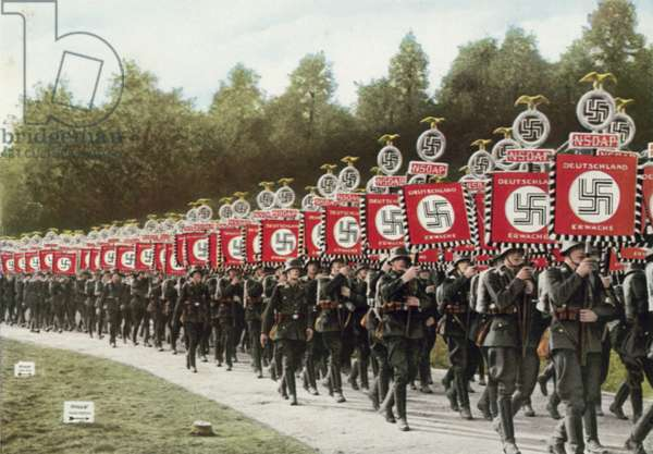 Procession carrying Nazi standards at the Nuremberg Rally, Germany, 1933 (colour photo)