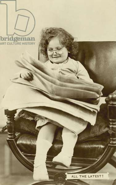 Young girl reading a newspaper (b/w photo)