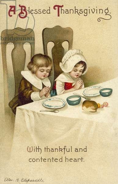 Two children praying at the dinner table: Thanksgiving greetings card (chromolitho)
