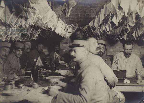 The French aviators' photographic section in the Marne,  Dining while the photos dry on the clothes line (b/w photo)