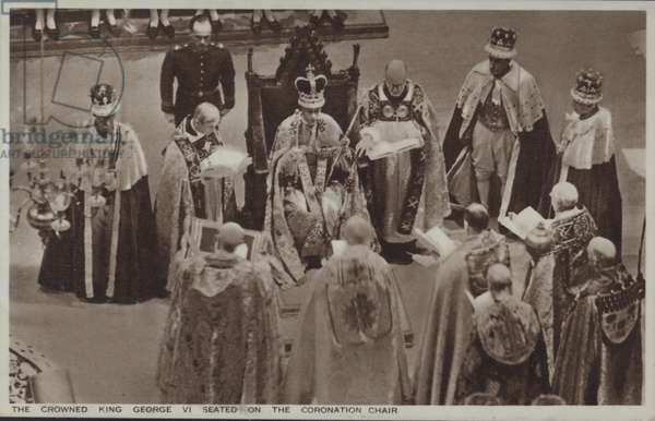 The crowned King George VI seated on the coronation chair (b/w photo)