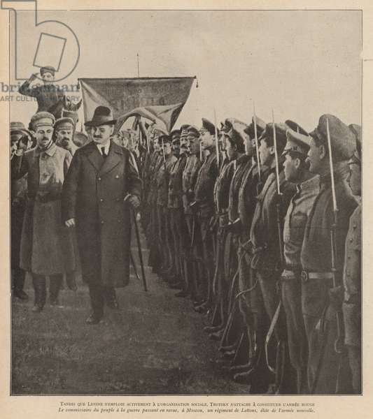 Russian Bolshevik revolutionary politician Leon Trotsky inspecting elite Latvian troops of the newly established Red Army in Moscow, 1918 (b/w photo)