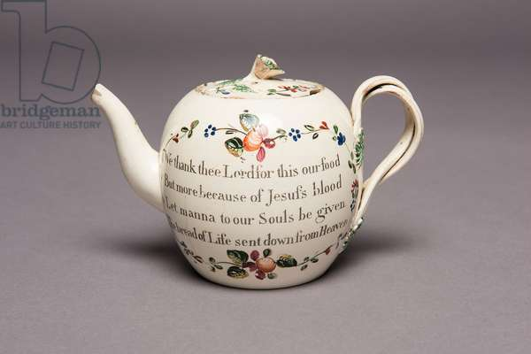 Teapot with Christian inscription, early 19th century (creamware)