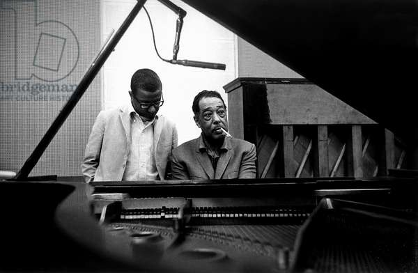 Duke Ellington sitting at grand piano with Billy Strayhorn, Universal Recording Studios, Chicago, 1963 (b/w photo)