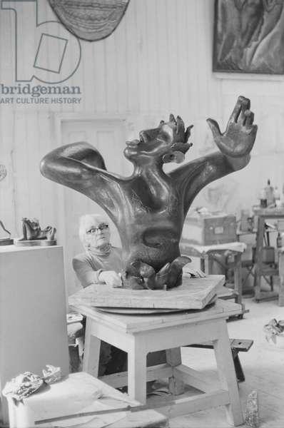 Leon Underwood in his studio with 'Phoenix for Europe' c.1971-72 (b/w photo)