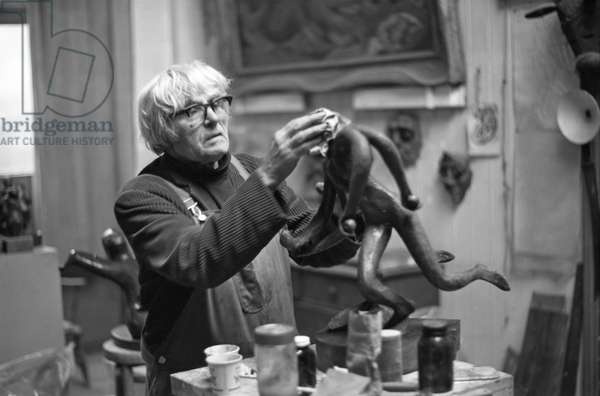 Leon Underwood working in his studio, 1969 (b/w photo)
