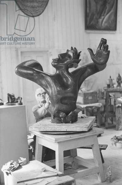 Leon Underwood in his studio with 'Phoenix for Europe', c.1971-72 (b/w photo)