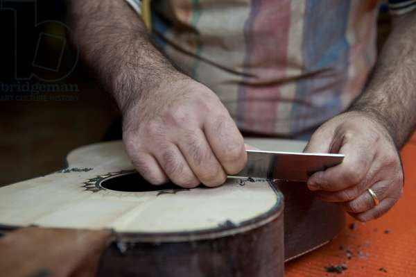 Master Luthier (Guitar-Maker)  making a classical Spanish guitar
