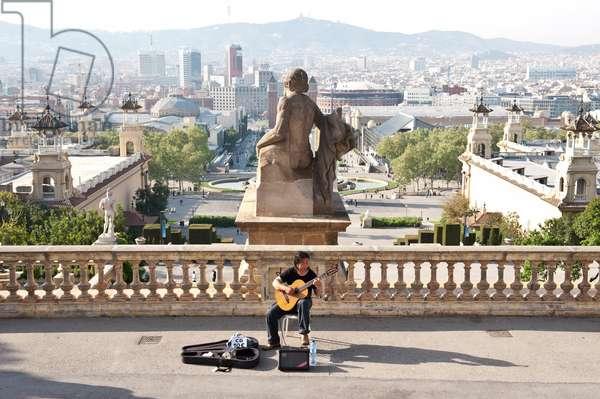 Guitar player performing in Montjuic, Barcelona, Spain