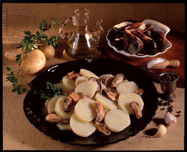 Food still life: potatoes and mussels salad