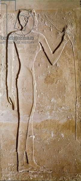 Egyptian antiquite: young woman has lotus flower. Limestone. 5th dynasty, 2300 BC. Dim. 145 cm Paris, Musee du Louvre