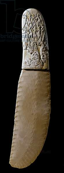 Egyptian antiquite: knife of Gebel El Arak (Gebel El-Arak). Carved ivory and flint blade. The handle is decorated with scenes inspired by the art of Mesopotamia. 3400 BC. Predynastic period. Paris, Musee du Louvre - Egyptian Antiquities: Gebel El Arak knife (Gebel el-Arak). Flint blade. The carved ivory handle is decorated with scenes showing the influence of the Mesopotamian art. 3400 BC. Pre-dynastic period. Louvre Museum, Paris, France