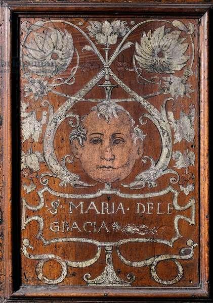 """Wooden plate decoree with a face and the inscription """"Santa Maria delle Gracia"""""""", sacristy del bramante 1429-1481 Basilica di Santa Maria delle Grazie Milan (wood bench decorated with a face and the inscription """"Santa Maria delle Gracia"""""""", Bramante sacristy)"""