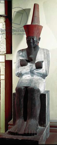 Egyptian antiquite: statue of the Pharaoh Montuhotep II (or Mentuhotep II). 11th dynasty. From Deir el Bahari. Dim. 83 cm. Cairo. Egyptian Museum