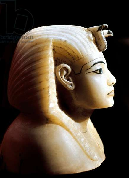 Egyptian antiquite: albaster canopy cover depicting the face of the pharaoh - From the treasure of Tutankhamun (all-Ankh-amun or Tutankhamun) (1345-1327 BC) 18th dynasty, found in the Valley of kings, Thebes, 1342 BC - Cairo, Egyptian museum - The Pharaoh Tutankhamun (134442 BC) 5-1327 BC) - Lid of an Alabaster Canopic Jar, Part of Tutankhamun's Treasures, c.1340 BC, From the Tomb of Tutankhamun, Valley of the Kings, Thebes - Egyptian Museum, Cairo, Egypt