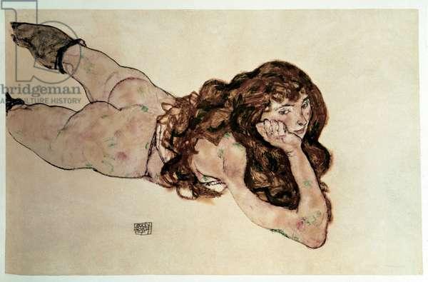 Naked feminine with flat belly. Drawing by Egon Schiele (1890-1918), 1917. Black chalk and tempera on paper. Dim: 29,8x46,1cm. Vienna, Graphische Sammlung Albertina