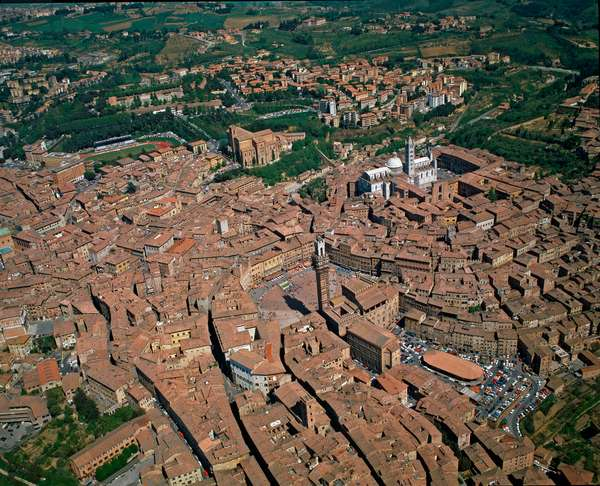 Aerial view of the city of Siena (Siena) with Piazza del Campo, Basilica di San Domenico (Basilica of Saint Dominica) and Duomo (Cattedrale di Santa Maria Assunta or Cathedrale of Saint Mary of the Assumption) in Tuscany, Italy