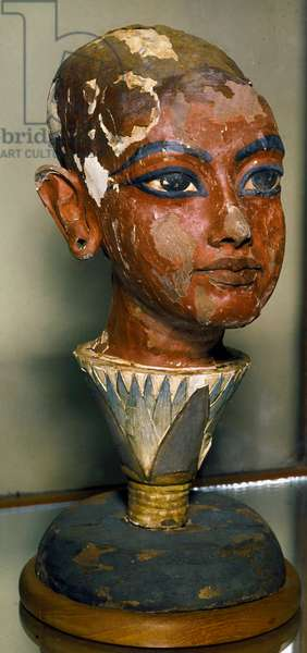 Egyptian antiquitis: portrait of the young pharaoh Tutankhamun (all-Ankh-amun or Tutankhamun) supported by a lotus leaf. Painted wood carving. From the Tresor of Tutankhamun. Egyptian Museum, Cairo.
