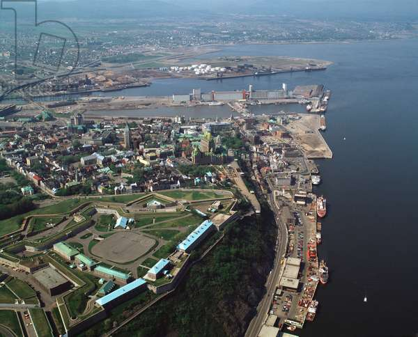 Air view of Quebec City on the St. Lawrence River with the Plains of Abraham and Chateau Frontenac, Canada, 1983 - Aerial view of Quebec city with the Plains of Abraham and the Chateau Frontenac by st Lawrence river, Canada, 1983 - Photography