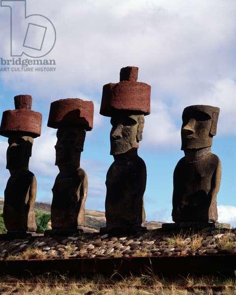 Group of Moais hats, Monolithic Monolithic Statues Easter Island (Isla de Pascua), Chile 1983 - Moais Naunau, wearing hats, monolithic human figures wearing hats, Rapa nui, Chile 1983
