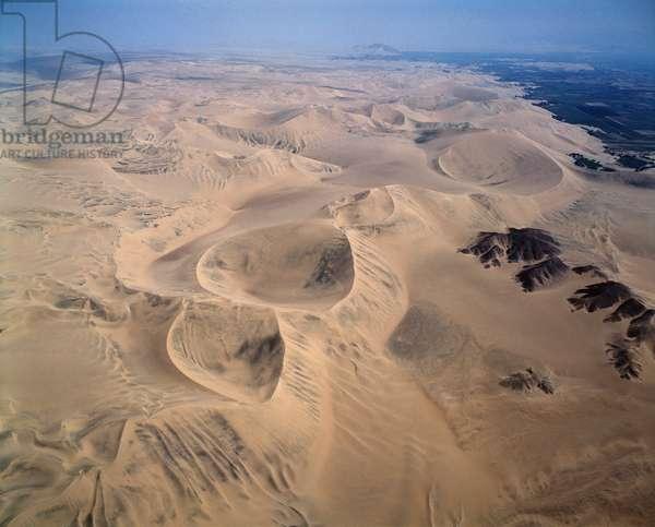 Aerial view of the desert near Huacachina oasis, Peru 1983 - Aerial view of the desert near Laguna Huacachina in Peru 1983