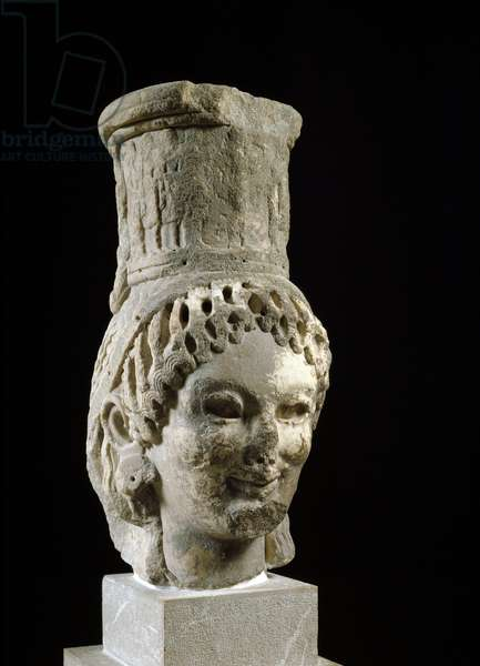 """Greek Art: """""""" caryatid head"""""""" Marble sculpture from the Tresor of Siphnos (or Tresor of the Siphnians). 530 BC. Delphi, archeological museum"""