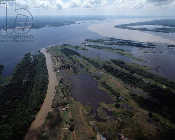 Aerial view of meeting point of river Rio Negro and Amazon river near city of Manaus, Brazil - Aerial view of meeting point of river Rio Negro and Amazon river near city of Manaus, Brazil, 1983 - Photography