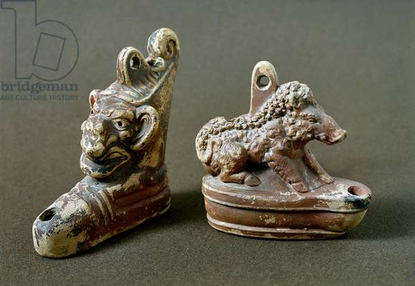 Small lamps with a monster head and a boar. 2nd century BC. (terracotta)