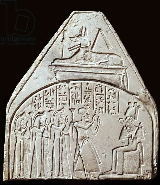 Egyptian antiquite: stele fragment representing the worship of the god Osiris. Above it is representing Anubis. Paris, Louvre Museum