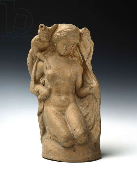 Earthenware statuette of Aphrodite or Hera kneeling , nude female figure wrapped in a cloak holds a dove in her right hand , from Paestum, Heraion di Foce Sele