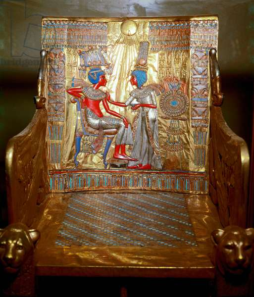 Egyptian antiquitis: a trone in golden wood and painted by Tutankhamun being part of the Pharaoh's Tresor. Representation of Queen Ankhesenpaaton (Ankhesenpaamon, Ankhesenamon) who massages with oil the shoulder of her brother and wife Tutankhamun under the rays of the sun god Aton. Thebes. Around 1340 BC. From the tomb of All-Ankh-Amon (Tutankhamun or Tutankhamun), Valley of the Kings, Deir el Bahari (Dayr al-Bahri). 18th dynasty. Dim. 104 cm Cairo. Egyptian Museum