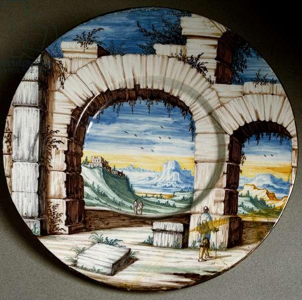 Ruin and landscape. Ceramic plate produced in Angarano, Italy. Around 1650 Florence, Museo Nazionale del Bargello