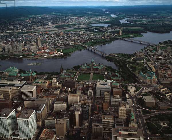 Air view of downtown Ottawa with Parliament and the River Ottawa, Canada, 1983 - Aerial view of Ottawa city center with the Parliament and the Ottawa river, Canada, 1983 - Photography
