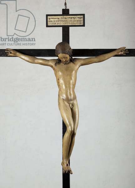Holy Spirit Crucifix, circa 1493, by Michelangelo (1475-1564), sculpture in polychrome wood, Sacristy of the Basilica of Santo Spirito in Florence - Crucifix. Renaissance sculpture by Michelangelo Buonarroti dit Michel Ange (Michelangelo or Michelangelo, 1475-1564), 1492. Church Santo Spirito, Florence.