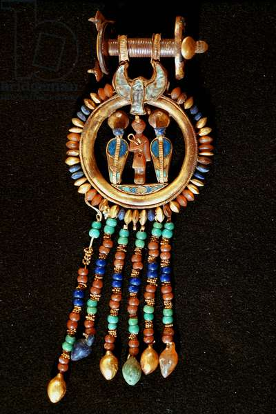 Egyptian antiquitis: earring with the effigy of Tutankhamun being part of the Tresor of the Pharaoh. Around 1340 BC. From the tomb of All-Ankh-Amon (Tutankhamun or Tutankhamun), Valley of the Kings, Deir el Bahari (Dayr al-Bahri). 18th dynasty. Cairo. Egyptian Museum
